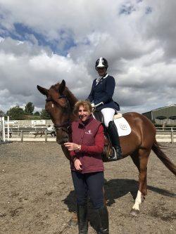 Lara riding Rara, with Heather Bennett.